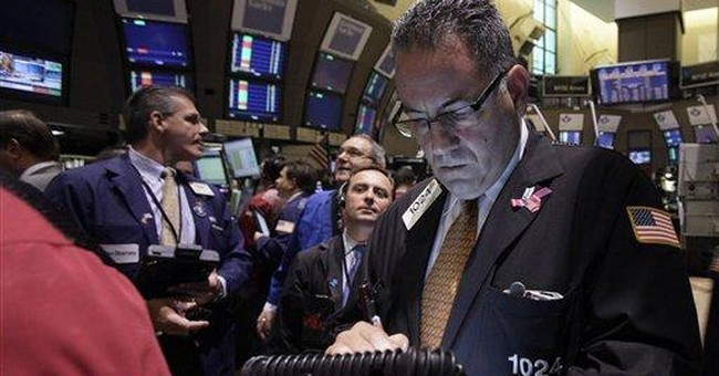 A late slide erases stock market gains