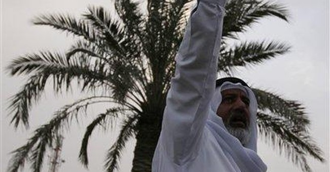 Bahrain hunger striker in wheelchair at hearing