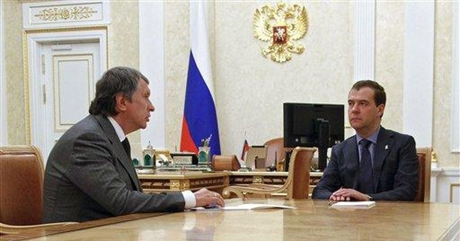 Russian energy czar Sechin takes helm at Rosneft