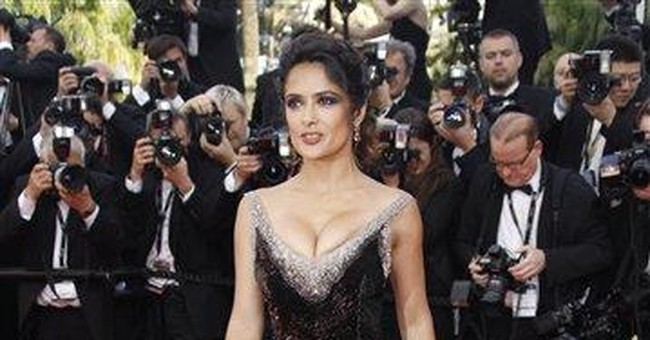 AP Photos: Cannes red carpet gets Bond girl flair