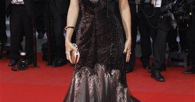 AP Photos: Cannes red carpet gets Bond girl flair