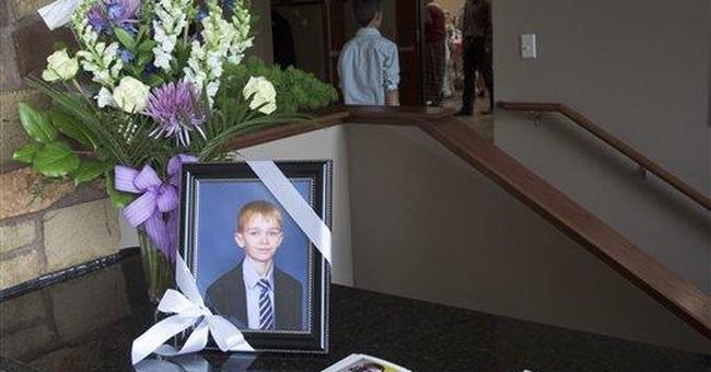 Russian boy killed in Nebraska fire laid to rest