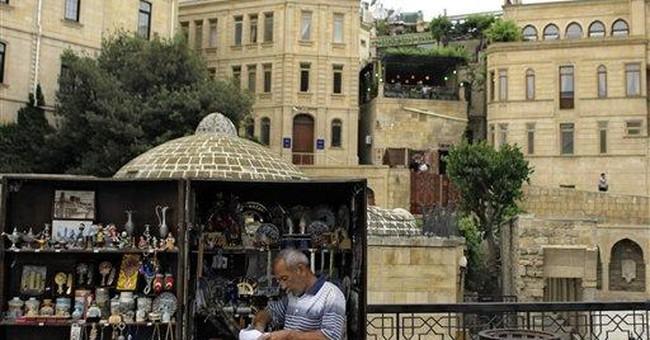 Azerbaijan basks in glitz, fears exposure