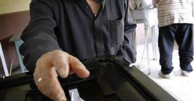 In Egypt vote, families debate on generation lines