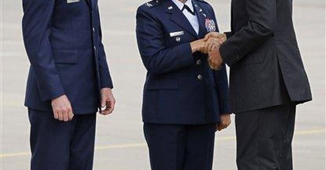 Obama strikes at Romney in Iowa, seeks 2008 energy
