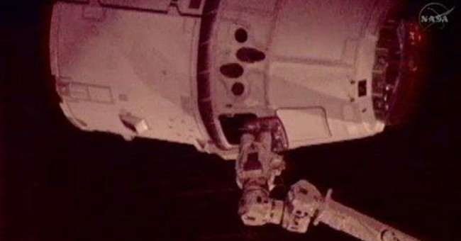 Dragon makes history with space station docking