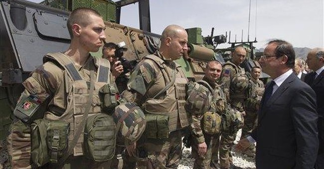 French president: All combat troops out in 2012