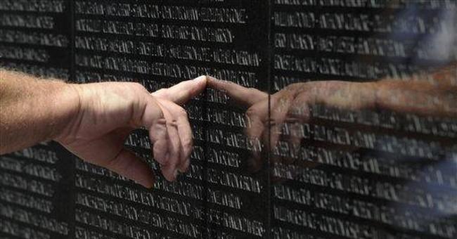 Obama honors veterans during Memorial Day weekend