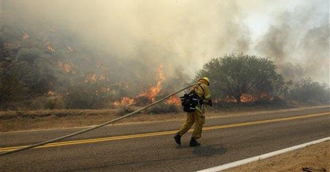 New Mexico fire grows, forces evacuation