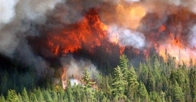 Crews work to protect structures in Mich. wildfire