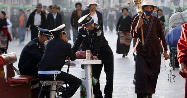 2 Tibetans set selves on fire outside Lhasa temple
