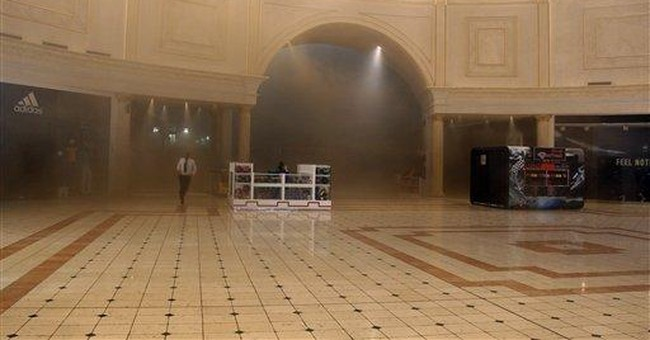 Qatar probes mall fire as young victims mourned