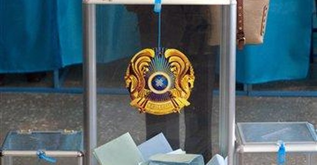 Kazakh ruling party's win tempered by criticism