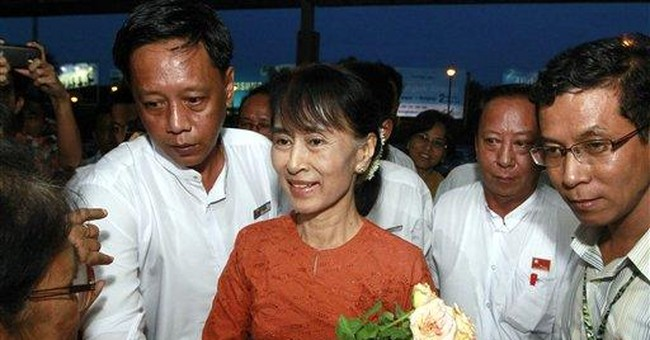 Suu Kyi, in Myanmar since 1988, starts world tour