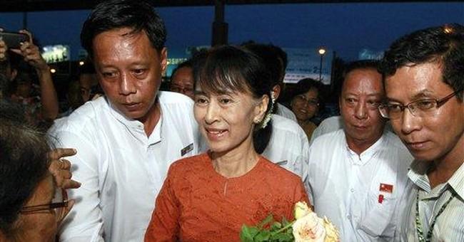Suu Kyi, in Myanmar since 1988, starts world tour