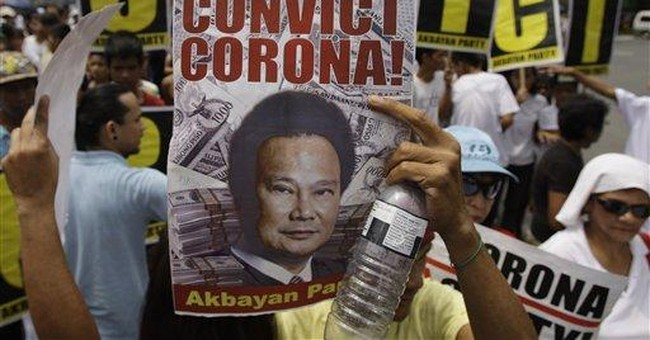 Top Philippine judge fired for not declaring $2.4M