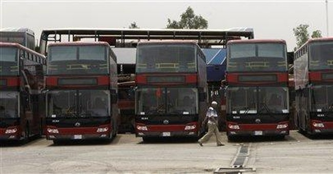 Red double-decker buses make a comeback in Iraq