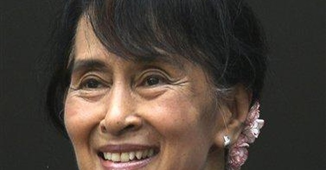 Suu Kyi presses for migrants' rights in Thailand