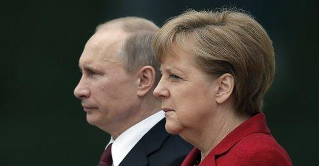Merkel presses Putin on Russian democracy
