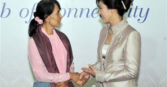 Suu Kyi gets ovation at first international speech