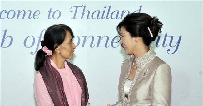 Suu Kyi gets ovation at first international speech