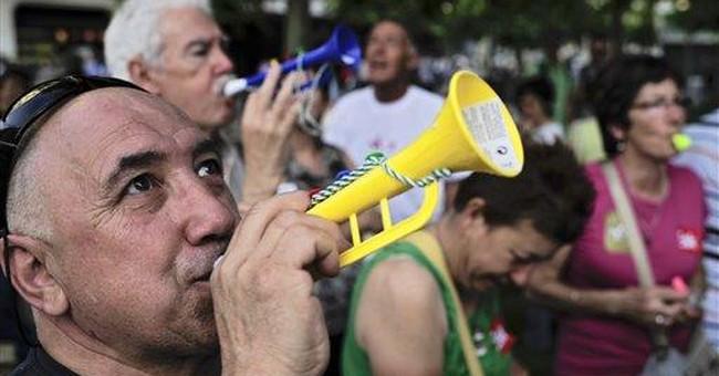 Spain tries to calm investors amid market pressure