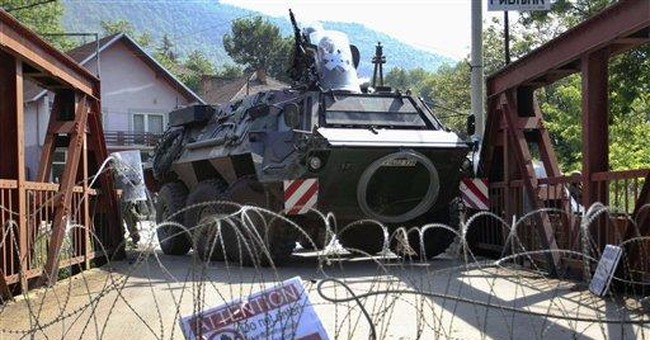 NATO troops exchange fire with Serbs  in Kosovo