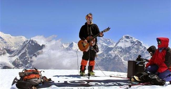 Musicians play to set record atop Himalayan peak