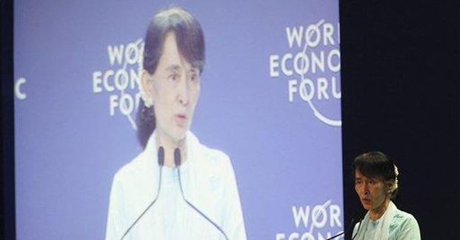 Myanmar's Suu Kyi says she's too busy for Facebook