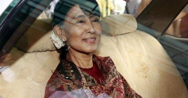 Myanmar state press lauds Suu Kyi's cooperation