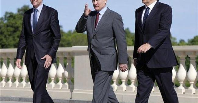 Putin defends Russia's human rights record