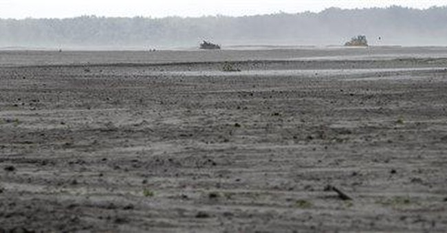 Feet of sand leave farms wasteland after flooding