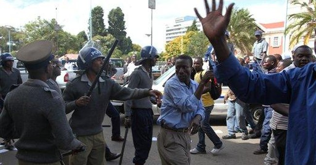 Zimbabwe police fire tear gas at protesters