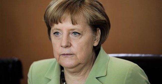 Merkel urges giving up more power to Europe