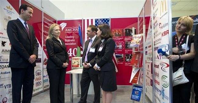 In Azerbaijan, Clinton meets top rights activist