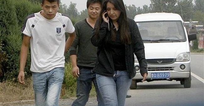 Surveillance ends at blind China activist village