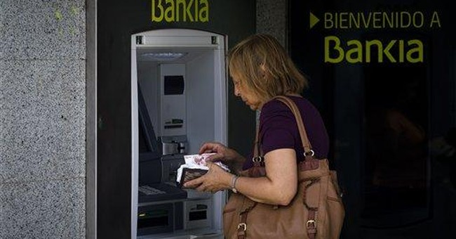 Spain's ailing banks threaten country's finances