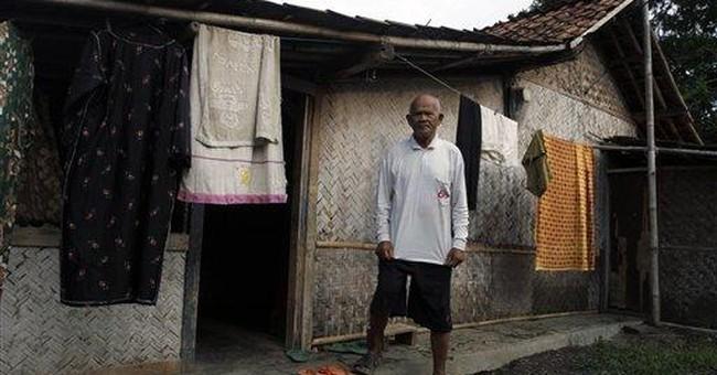 Indonesian village riven by massacre compensation