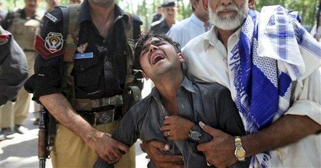 Bomb targeting government bus in Pakistan kills 19