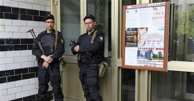 Russian police search protest leaders' apartments