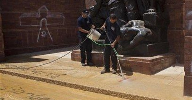 Hate graffiti sprayed at Israel Holocaust memorial
