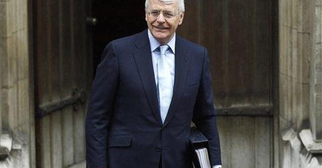 UK's John Major: Murdoch tried to change policy
