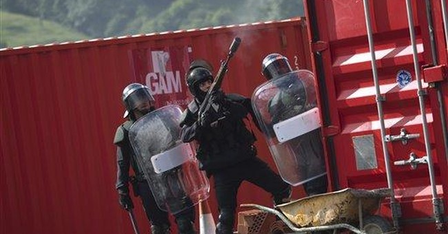 Striking miners in north Spain use violent tactics