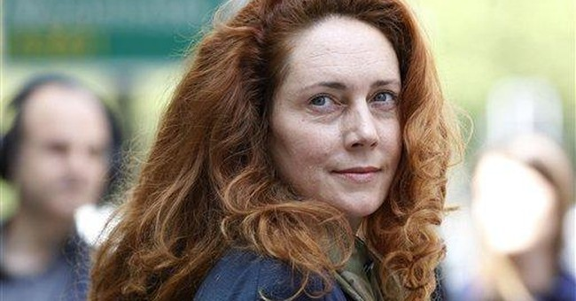 UK minister survives vote on Murdoch ties