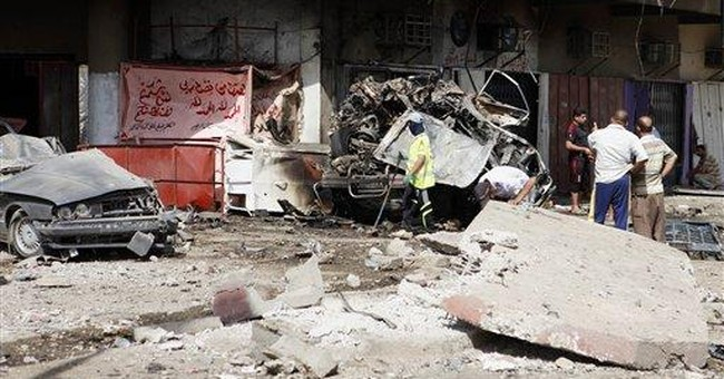 Bombs target pilgrims in Iraq, killing scores