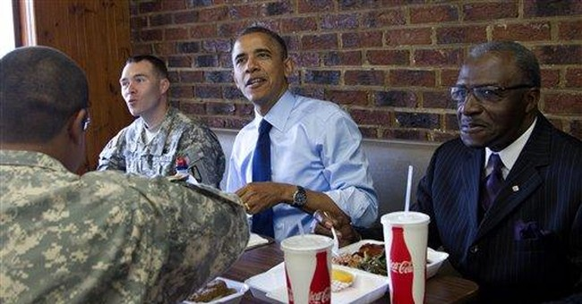 Obama honors dads, troops with ribs and greens