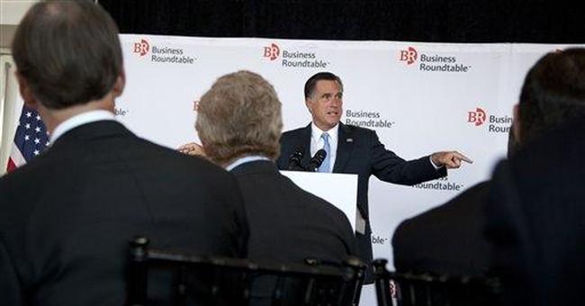 Romney amends budget goals, assails Obama's record
