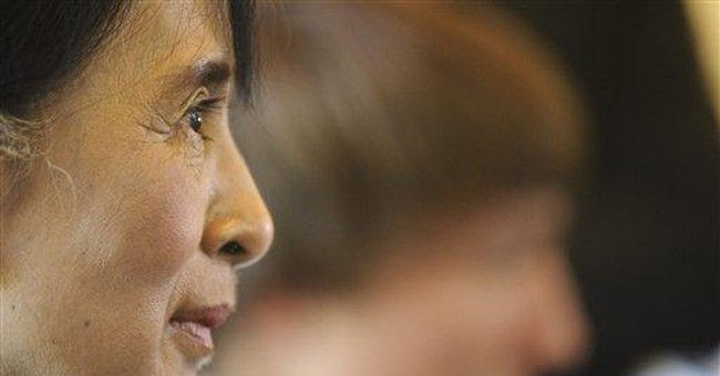 Exhausted Suu Kyi falls ill during news conference
