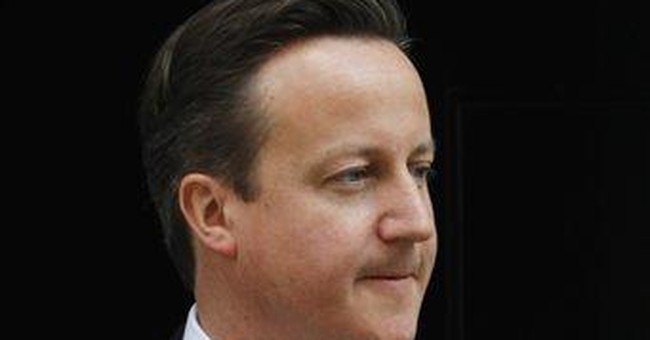 UK PM Cameron defends ill-fated Andy Coulson hire