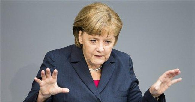 Merkel firmly behind euro, but will she act?